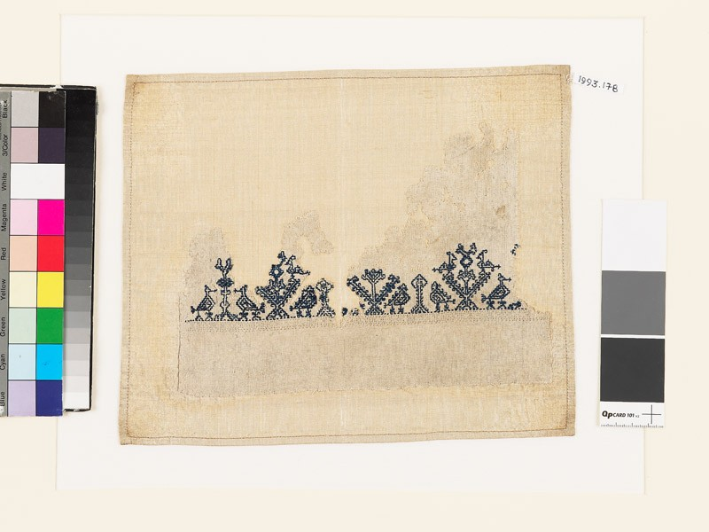 Textile fragment with stylized pairs of birds and trees (front            )