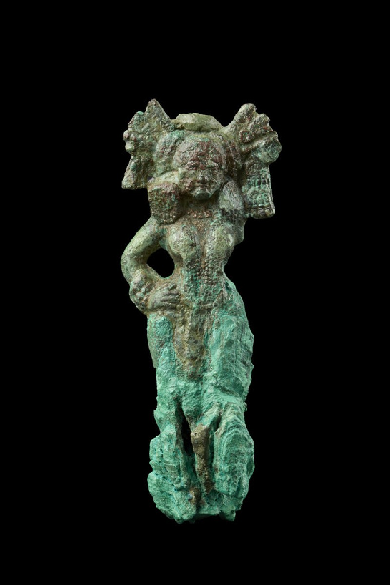 Figure of a female with elaborate headdress, possibly a yakshi