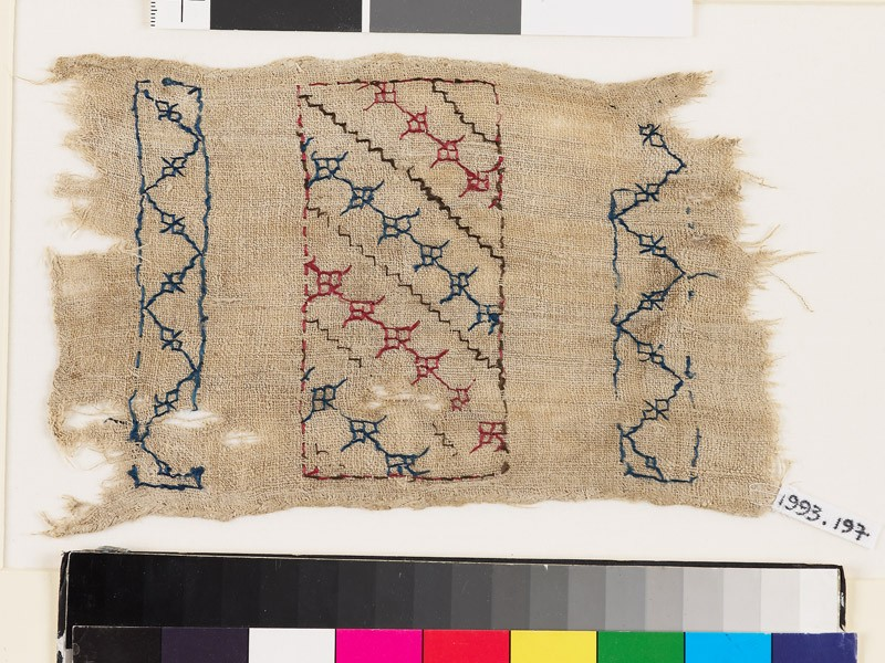 Textile fragment with steps, florets, and chevrons (front            )