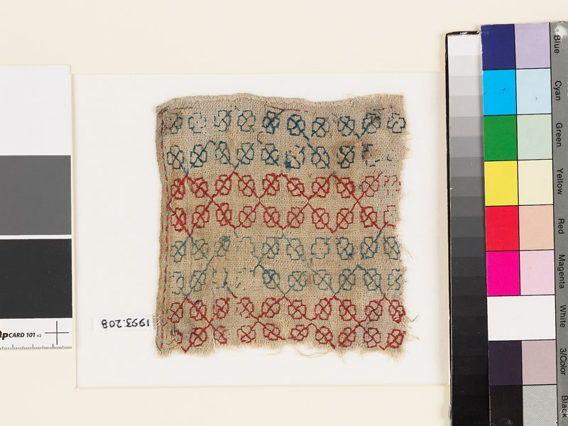 Textile fragment with rosettes and stems