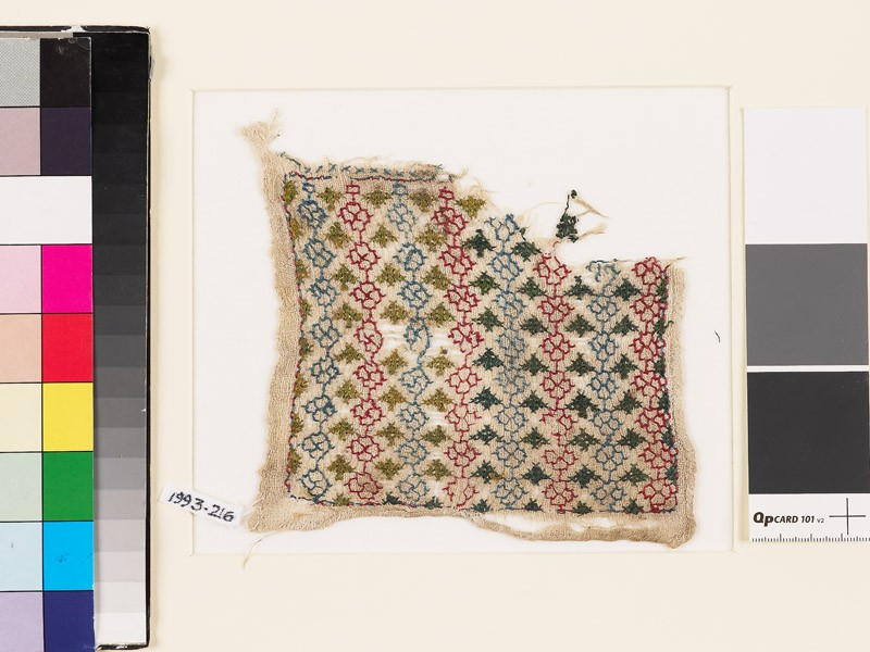 Textile fragment with linked rosettes and leaves (EA1993.216, front            )