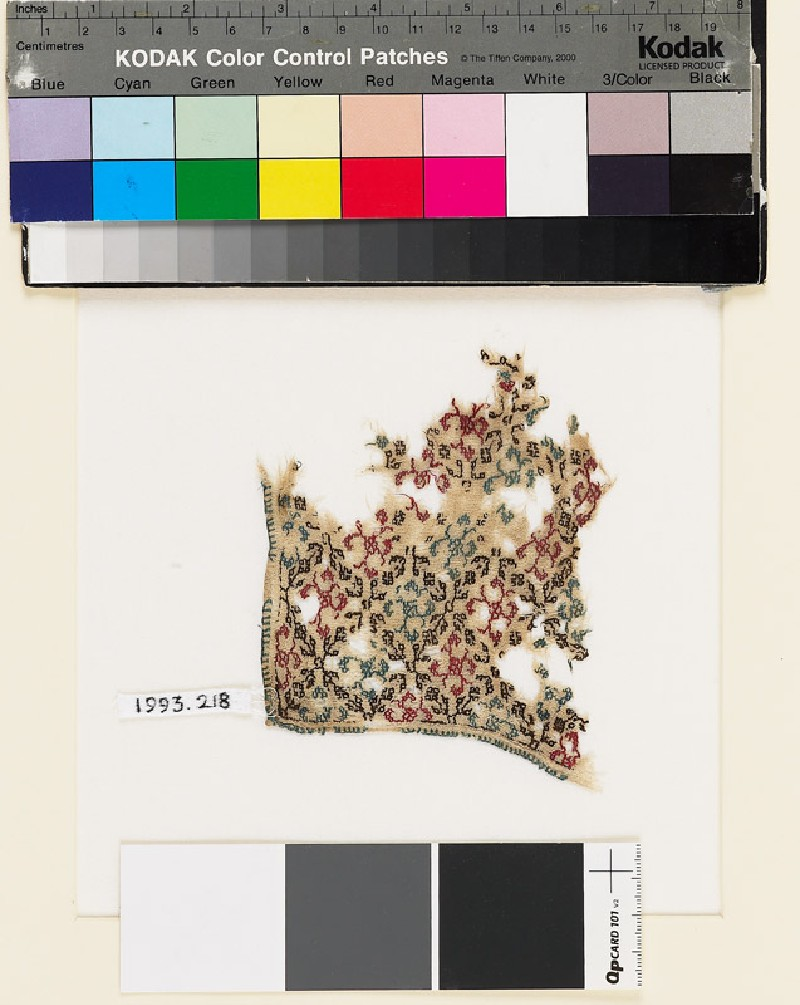 Textile fragment with rosettes and lattice of diamond-shapes