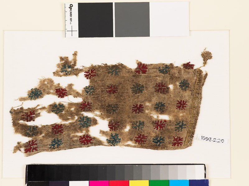 Textile fragment with stars and triangles