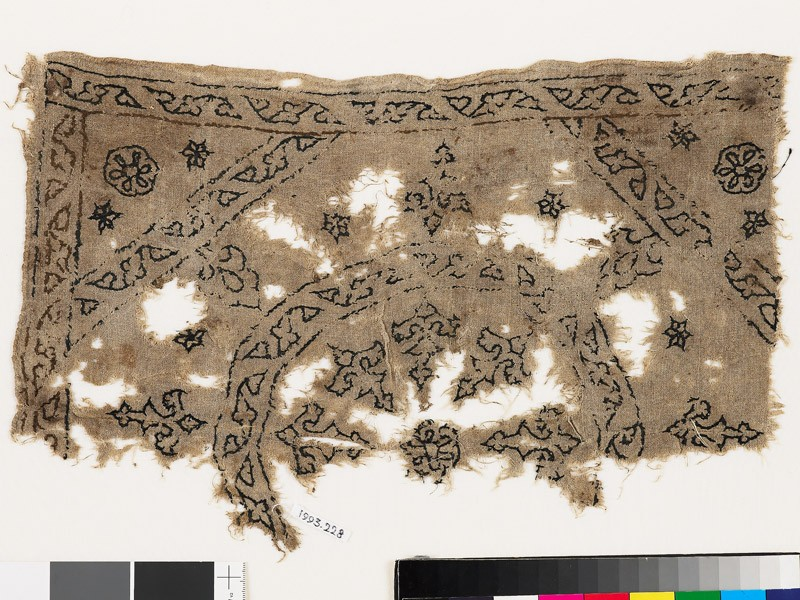 Textile fragment with remains of a roundel, octagon, square, and plant shapes