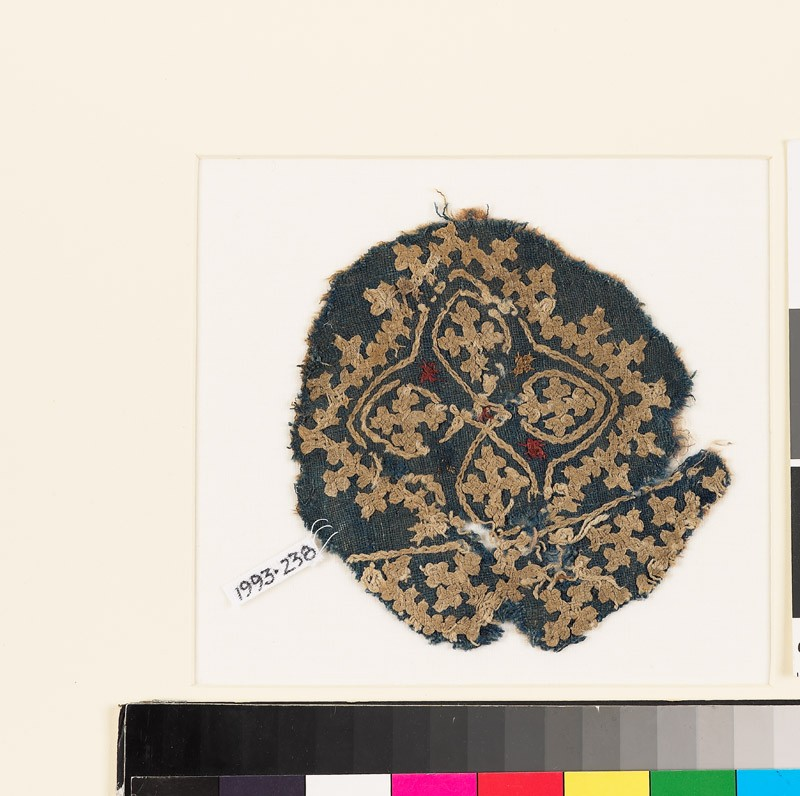 Roundel textile fragment with quatrefoil and linked crosses
