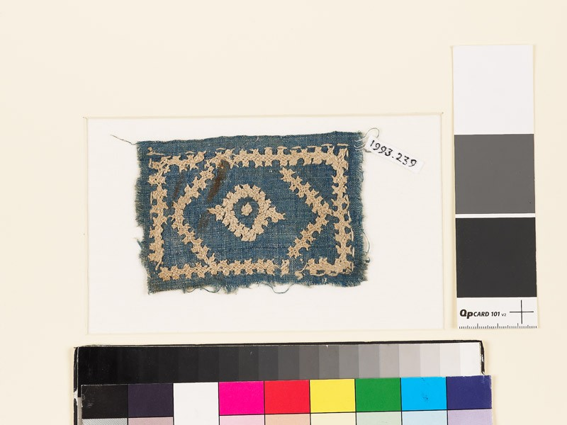 Textile fragment with diamond-shape, hexagon, rectangle, and linked crosses (front            )