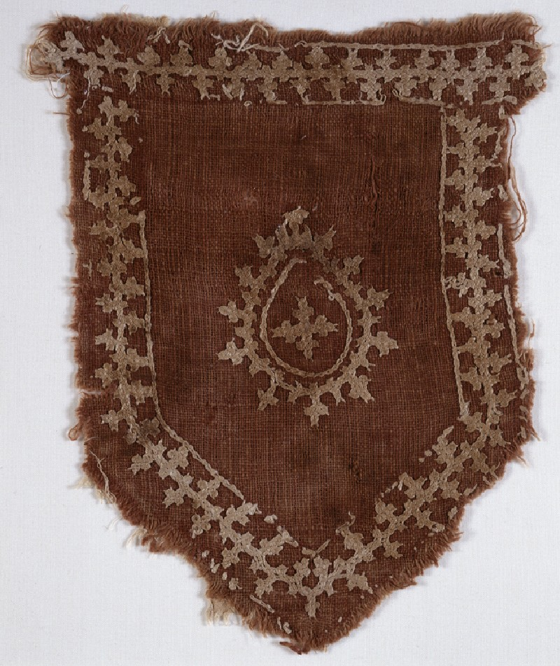 Tab with linked crosses and pear-shaped medallion