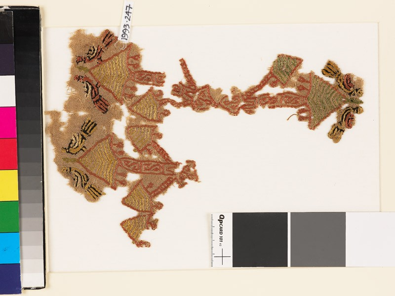 Textile fragment with pairs of birds and trees