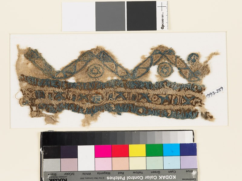 Textile fragment with chevrons, circles, and stars (EA1993.259, front            )