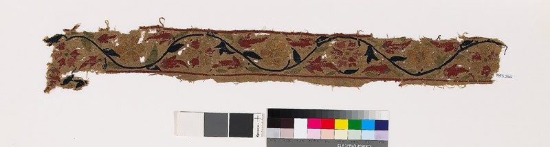 Textile fragment with flowers, leaves, and stem