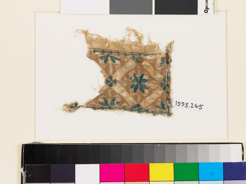Textile fragment with rosette, diamond-shape, and square