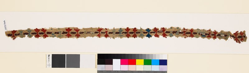 Textile fragment with pairs of stylized buds