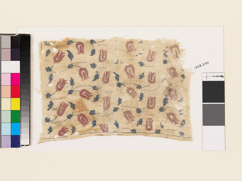 Textile fragment with tulips, leaves, and stems