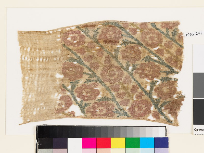 Textile fragment with flowers, buds, and leaves, probably from a sash or scarf