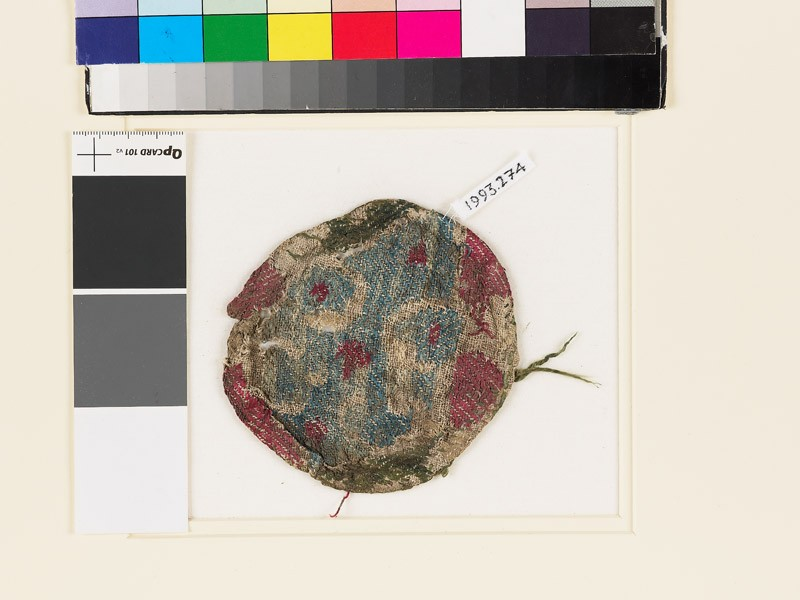 Roundel textile fragment with elaborate lobed cross (front            )
