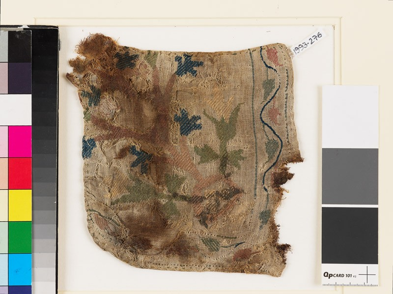 Textile fragment with plant, flowers, and leaves, possibly from a pocket (front            )