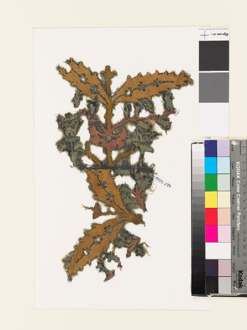 Textile fragment with pairs of leaves and bell-shaped flowers