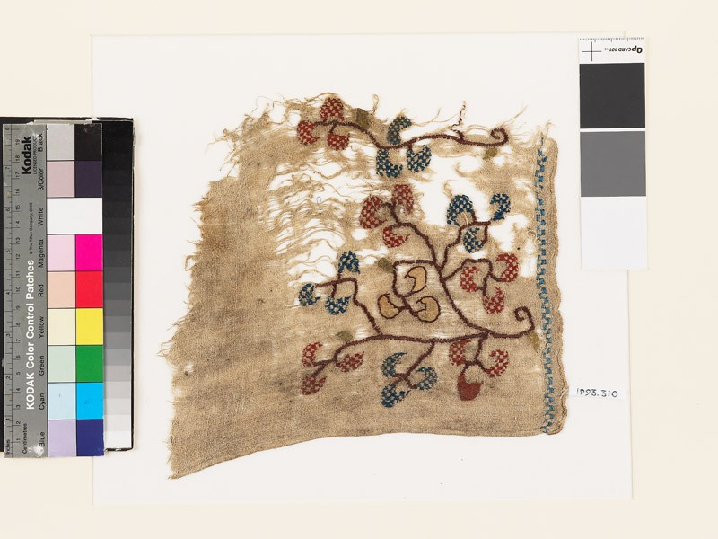 Textile fragment with stylized floral spray and chevrons