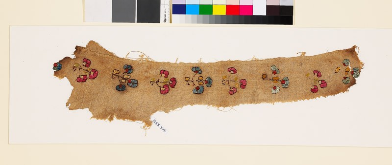 Textile fragment with stylized floral shapes