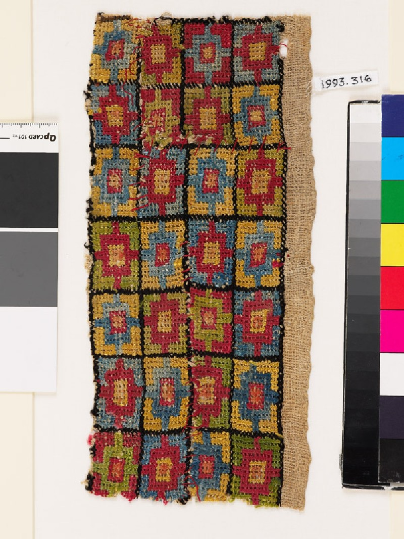 Textile fragment with chequerboard pattern