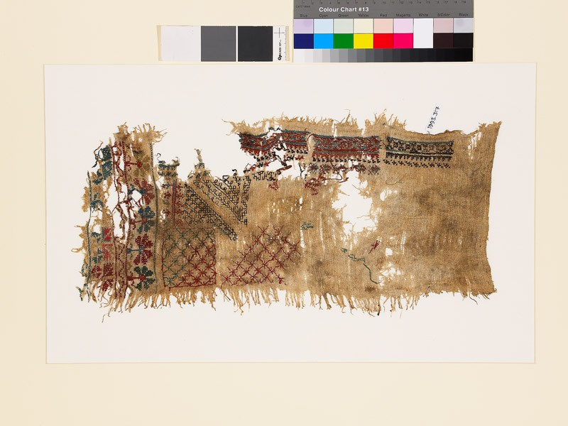 Sampler fragment with lattice, stars, and geometric and floral shapes (front            )