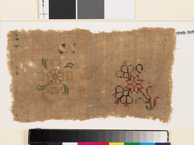 Sampler with stylized floral shapes and S-shapes (EA1993.325, front            )