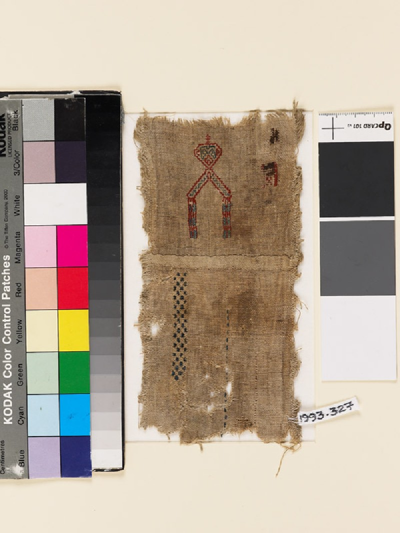 Textile fragment with V-shape, geometric band, and check pattern, probably from a sampler