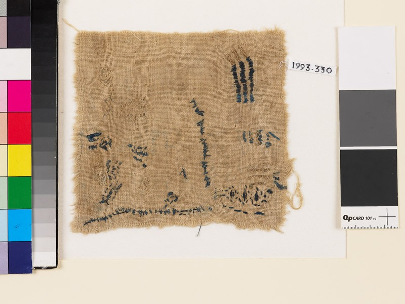 Textile fragment with chevrons and irregular lines (front            )