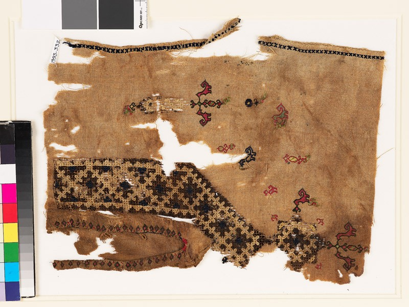 Textile fragment from the neck of a tunic with a V-shape, birds, and plants (EA1993.332, front            )