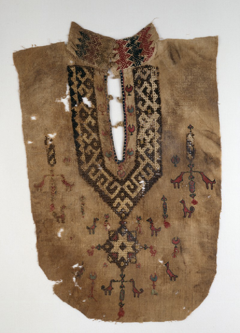 Part of a tunic front with geometric pattern and birds