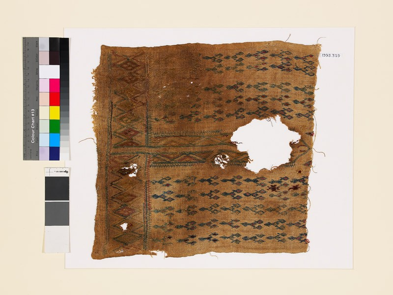Textile fragment with linked diamond-shapes, possibly from the front of a garment