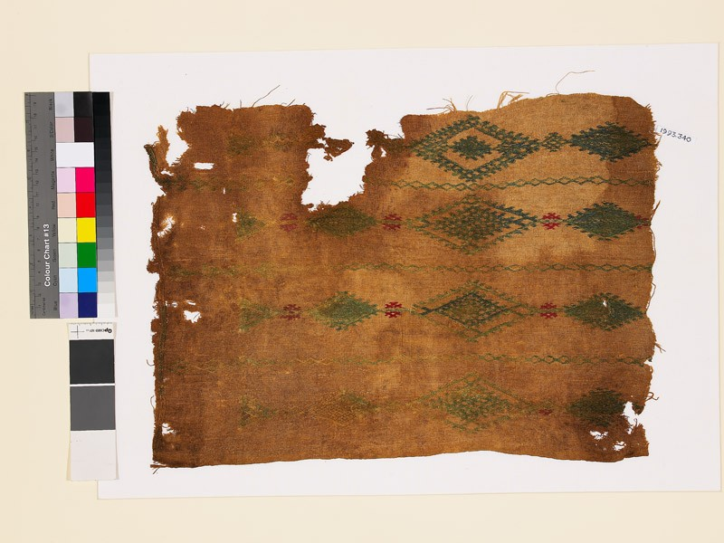 Textile fragment with linked diamond-shaped medallions and lattice (front            )