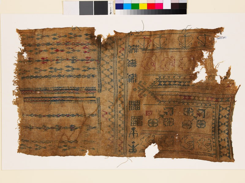 Sampler fragment with linked diamond-shapes, stylized floral shapes, and stylized figures