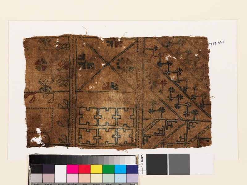 Sampler with geometric shapes, stylized floral shapes, and flower-heads