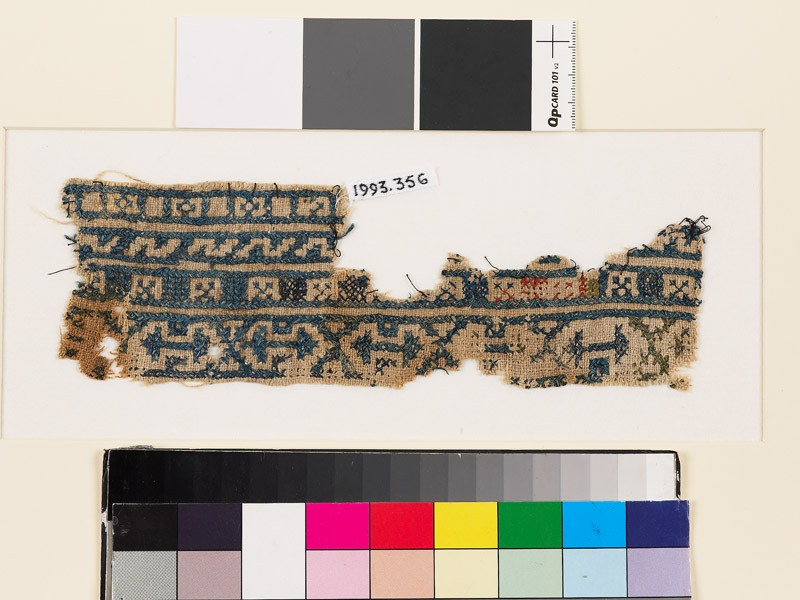 Textile fragment with bands of arrowheads, squares, and Z-shapes