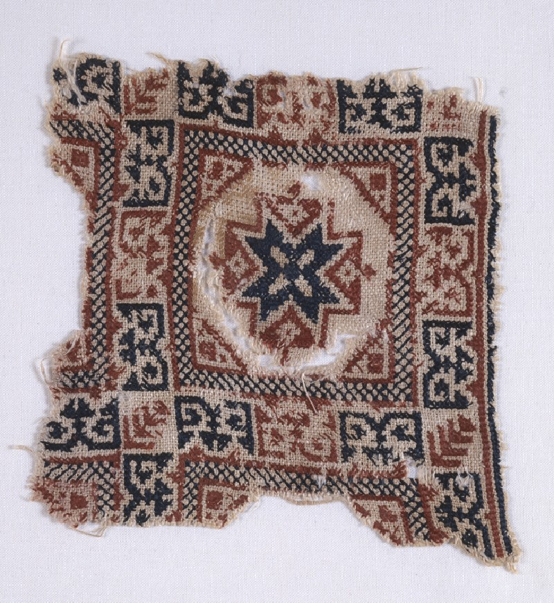 Textile fragment with star and pseudo-inscription (front            )