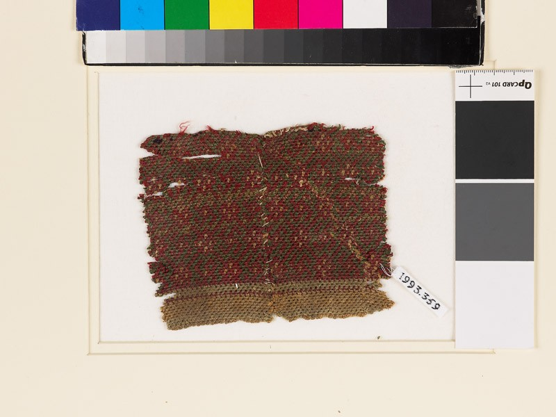 Textile fragment with large and small diamond-shapes