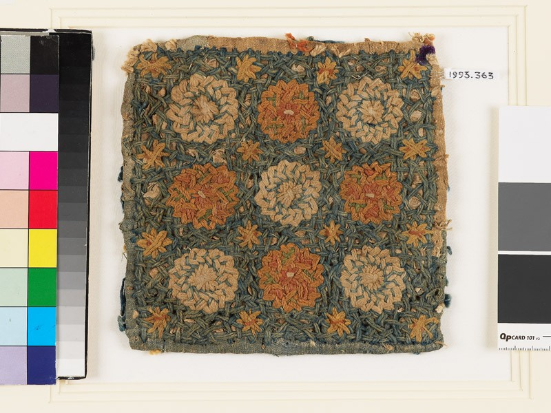 Textile fragment with circles, stars, and interlace, possibly a pot holder (front            )