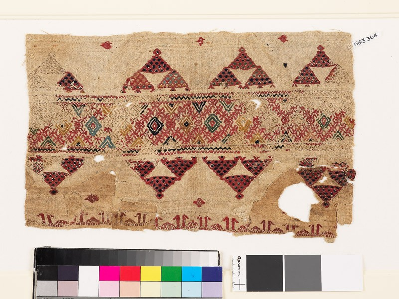 Textile fragment with band of diamond-shapes, triangles, and pseudo-kufic inscription (EA1993.364, front            )
