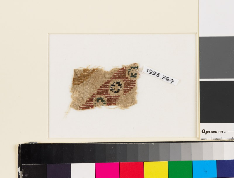 Textile fragment with diagonal band of rosettes in squares (front            )
