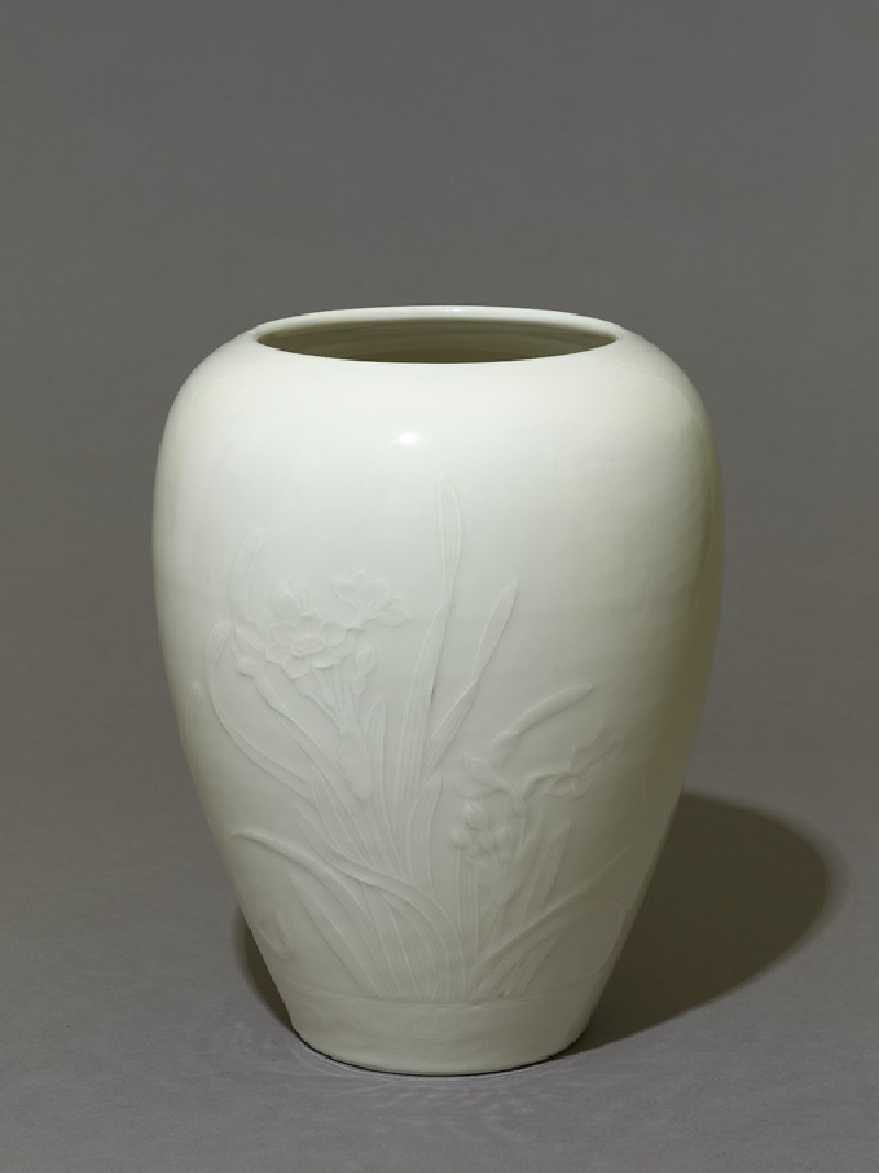 Vase with narcissi and a wagtail