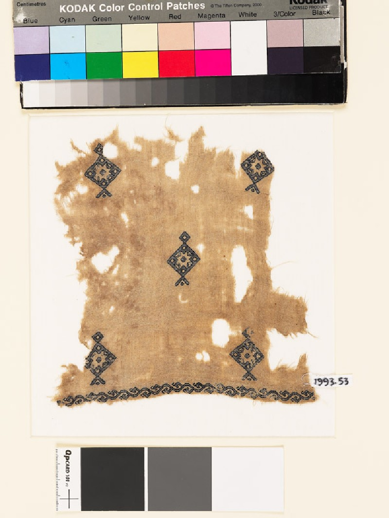 Textile fragment with diamond-shaped medallions and stars