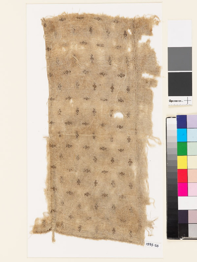 Textile fragment with diamond-shaped medallions