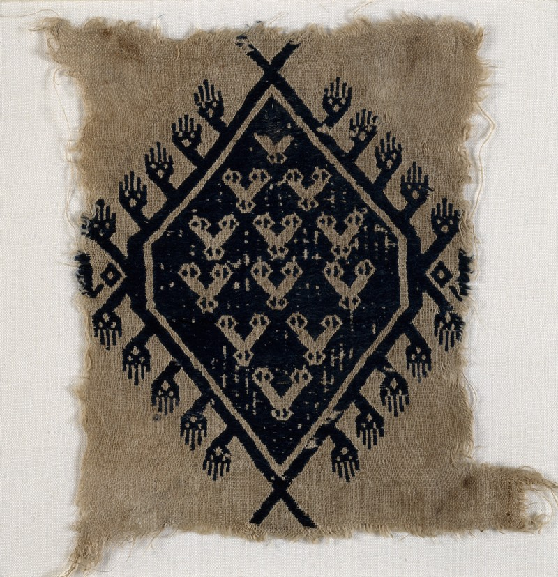 Textile fragment with hands and diamond-shaped medallion (front           )