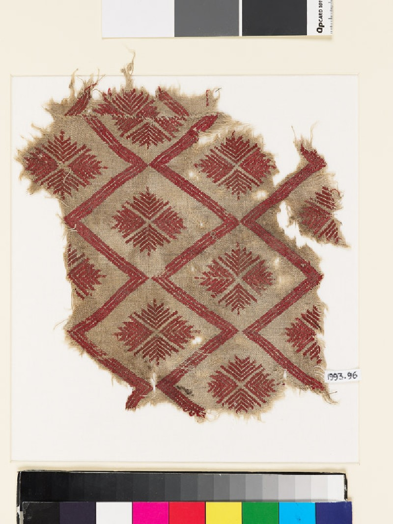Textile fragment with chevron and cruciform rosettes (front           )