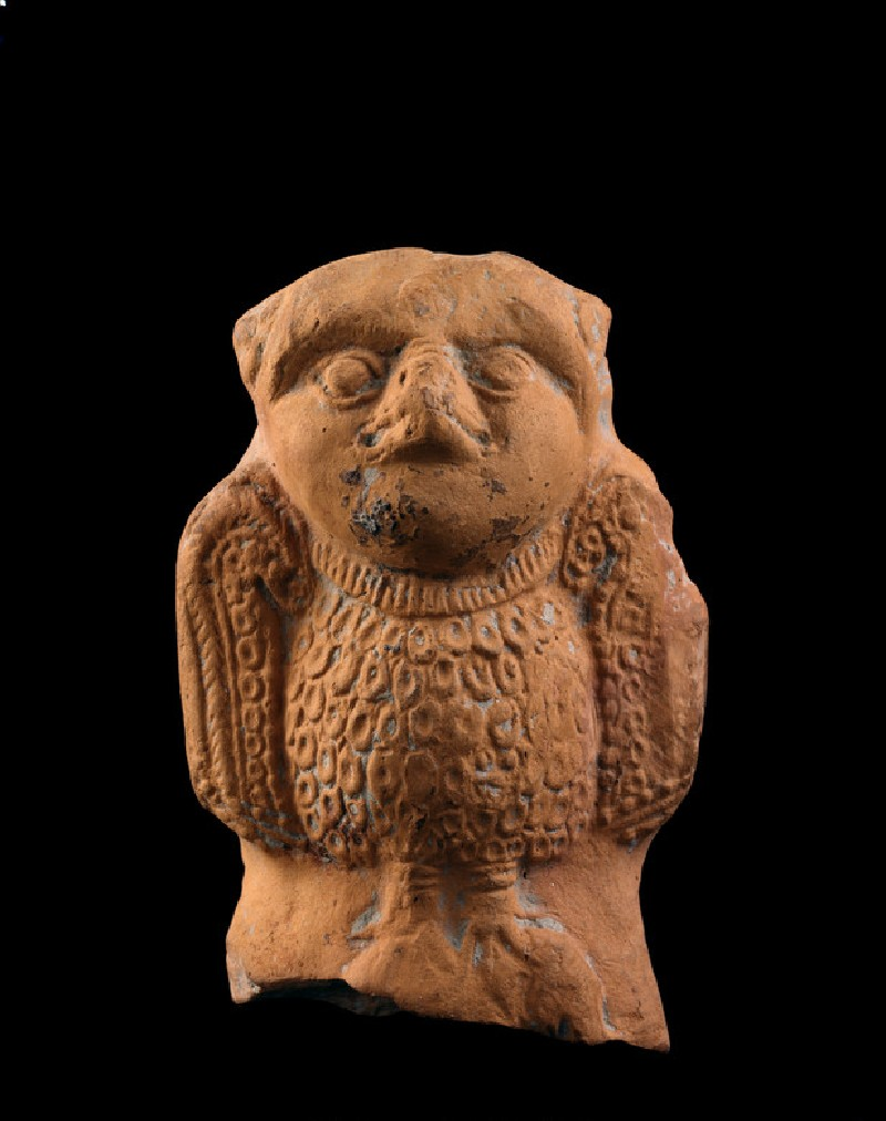 Toy cart fragment in the shape of an owl (EA1994.73)
