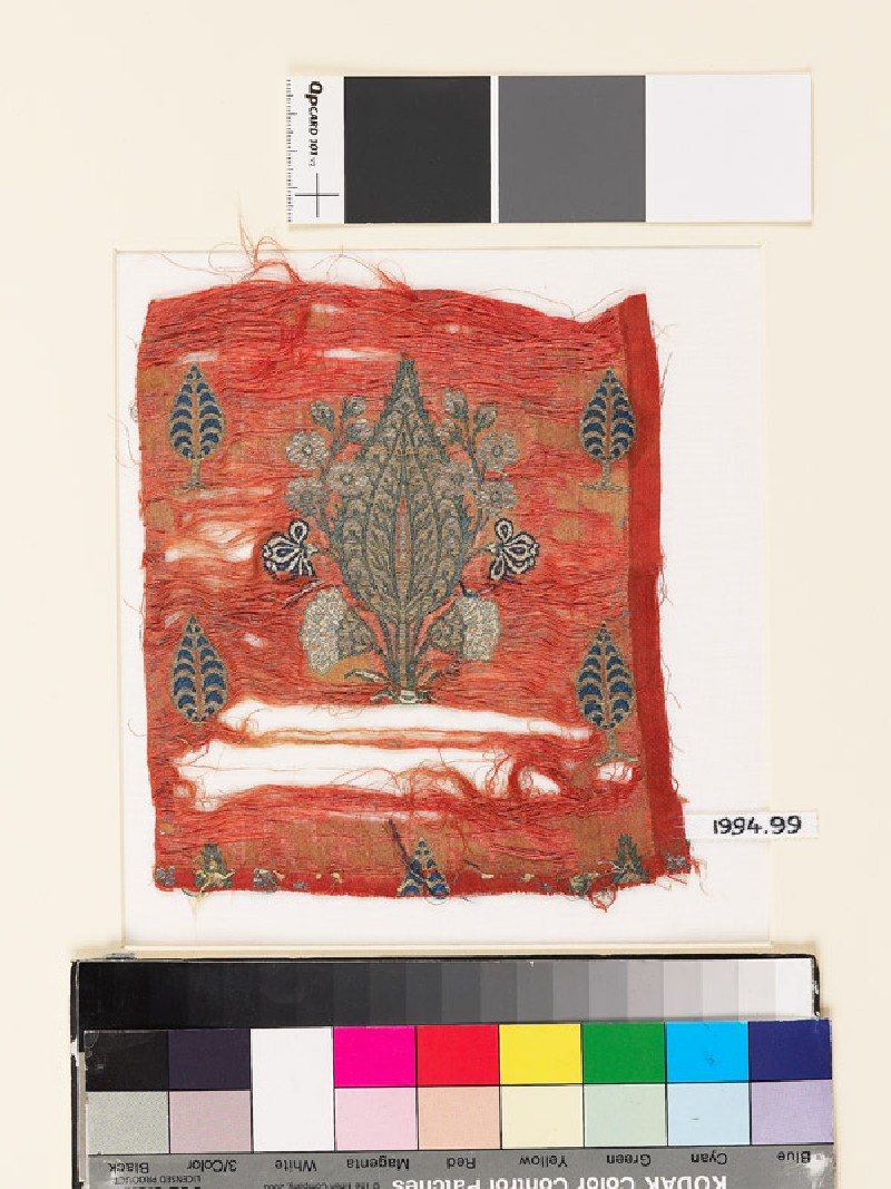 Textile fragment with cypress trees
