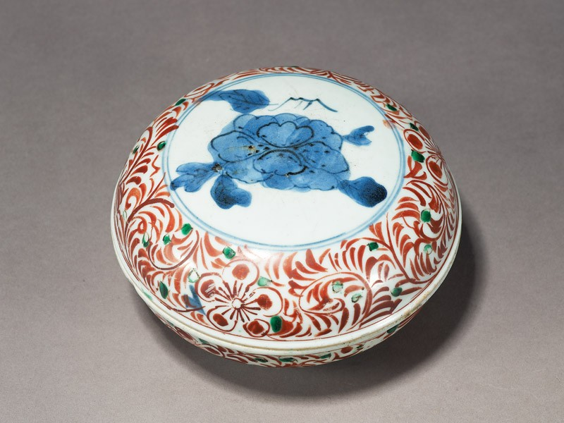 Box with peony enclosed by a floral scroll border (oblique          )