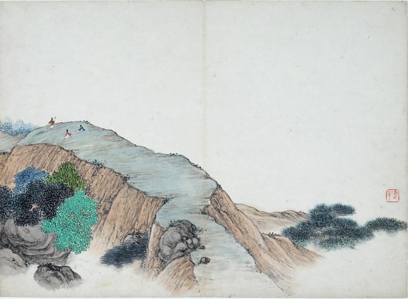 Three figures on a mountain ridge