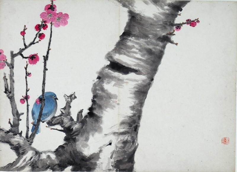 Blue bird sitting on a plum blossom tree